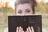 young adult woman holding an old Book of Mormon