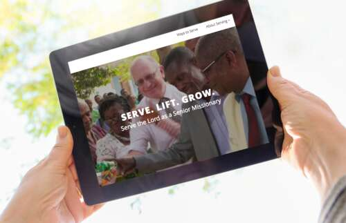 tablet with image of people cutting ribbon