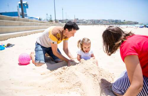 Darren and Stacey with daughter at the beach