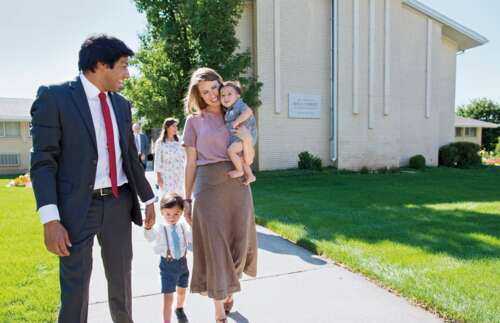 family walking outside a church